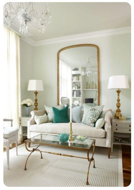Sarah richardson design light green walls paint color floor length gold mirror sarah richardson nicole sofa with green pillows antique brass glass top