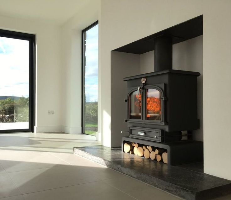 Contemporary Minimal White Fire Surround with a Clearview Stove and a Polished Concrete Hearth by Sand and Sawn