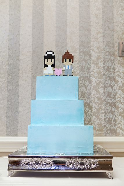 I looooovvve this bride's dress! and their cake! it's an 8 bit version of themselves made out of legos! <3