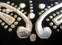 Silver foil screen print with fixative (glue) in beige by Mabuzi.com