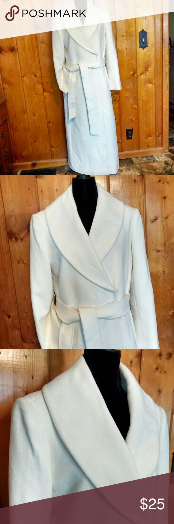 Plus size Spiegel white trench coat Plus size Spiegel white trench coat. Never worn. There are a few  tiny little spots that may be a moth bite. On the right lapel.  ( See picture 5.) They are tiny and not holes but I wanted to note them. This is a beautiful addition to any wardrobe !! Spiegel Jackets & Coats Trench Coats
