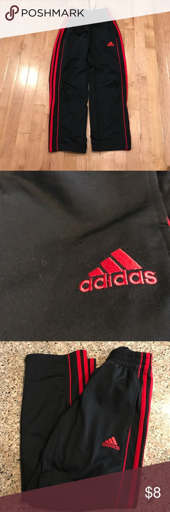 "Boys adidas track pants Boys Black and red classic adidas track pants. Black with red stripes, size 8, 31"" in length, 20"" waist unstretched. Adidas Bottoms Sweatpants & Joggers"