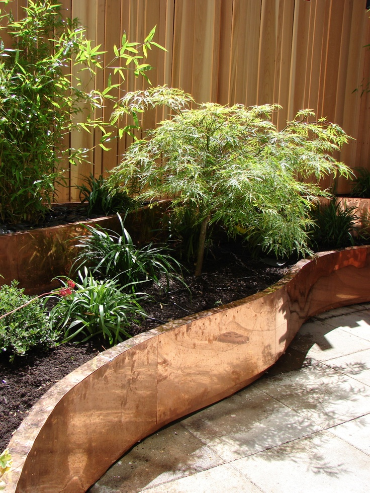 copper  planters,  cedar     fencing on    city  terrace