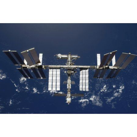 The International Space Station backdropped by a blue and white Earth Canvas Art - Stocktrek Images (35 x 23)