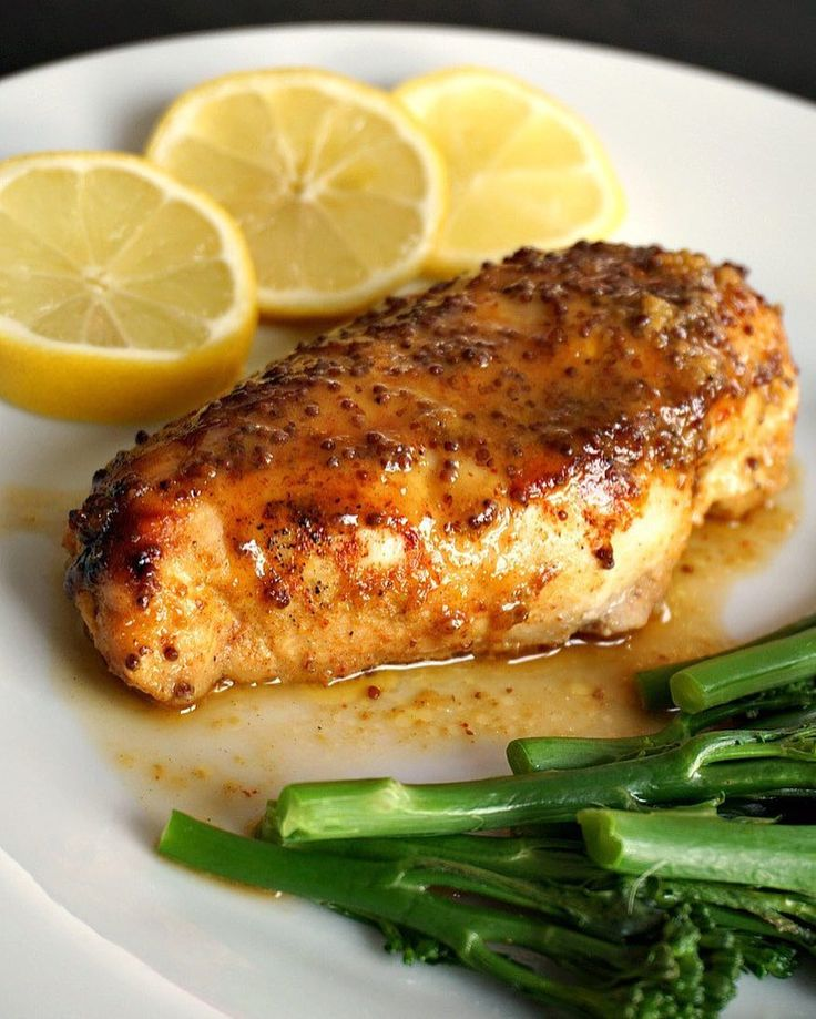 🌎🐔Baked honey mustard chicken breast with a touch of lemon! . Recipe Author: Daniela Anderson of mygorgeousrecipes.com Serves 2 Ingredients 2 chicken breasts 1 tbsp dijon mustard 1 tbsp wholegrain mustard 1 tbsp honey salt and pepper to taste 1/4 tsp paprika juice from 1/2 lemon 1/2 tbsp oil (or butter) broccoli spears to serve .  Instructions Preheat the oven to 200 degrees Celsius (400 degrees Fahrenheit). Grease an oven-proof dish with the oil or butter and place the chicken in there…