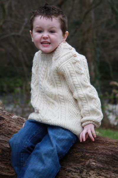 Irish Sweaters for Kids. Each sweater features extreme attention to detail. The main feature of this collection is the traditional Irish cable knit and intricate honeycomb stitch pattern.