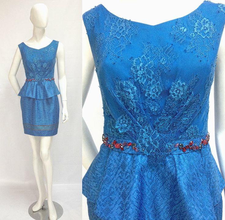 ta Dress This chic peplum dress sets a vibrant, elegant tone. The peplum detail is universally flattering. The dress has a double V neckline