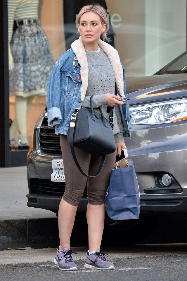 Hilary Duff wearing Givenchy Antigona Satchel, Nike Flyknit Lunar 3 Running Shoe, Lululemon Athletica In The FLow Crop II , Levi's Vintage Pale Blue Denim Fleece Lined Jacket