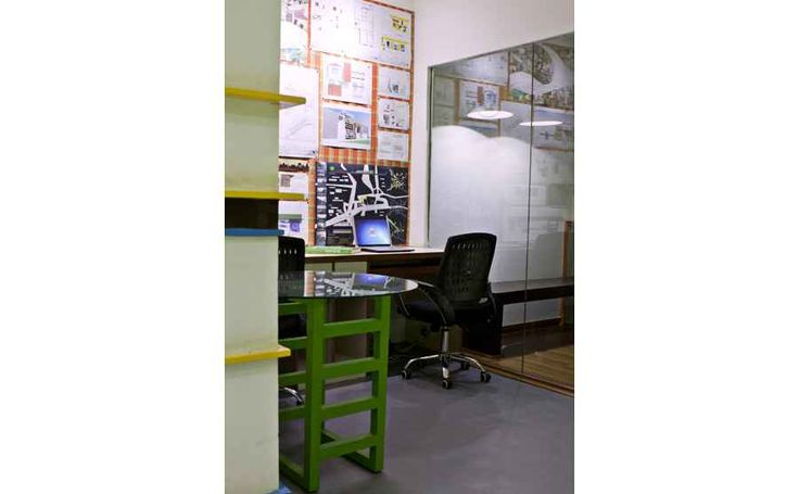High rise display creates an aesthetically pleasing environment while serving the purpose of maximum display for an Architect's Studio.