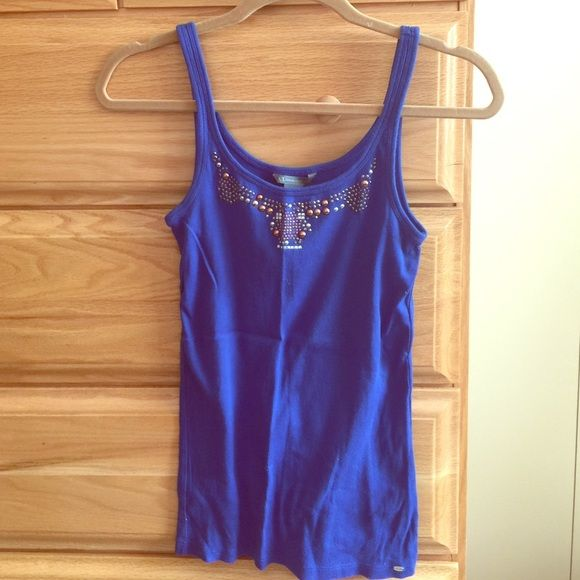 Armani Exchange Fashion Top Stretchy, fitted blue tank top with studs by Armani Exchange. Great condition. May be missing a stud in center. Size Large. Armani Exchange Tops Tank Tops