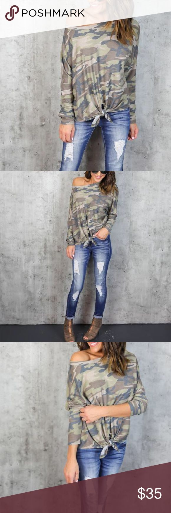 """Camo print front knot sweatshirt pullover top This statement piece is ultra soft and comfortable in dolman style ! The knot in the front can be tied to your preference and defines this cute piece to keep in on trend and in style! Wear this with joggers on the weekendor mix it up with bold accessories for a more elevated look. Made in the US! Length: Shoulder to hem length on a size small measures 22""""Runs: True to sizeCare:Hand Wash Cold/ Gentle Cycle Sweatshirt is 85% Polyester, 10%…"""