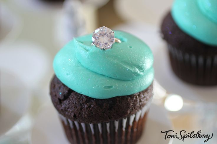 Tiffany-colored cupcakes for my Breakfast at Tiffanys themed birthday party. Achieving the actual Tiffany-blue color is difficult and most printers