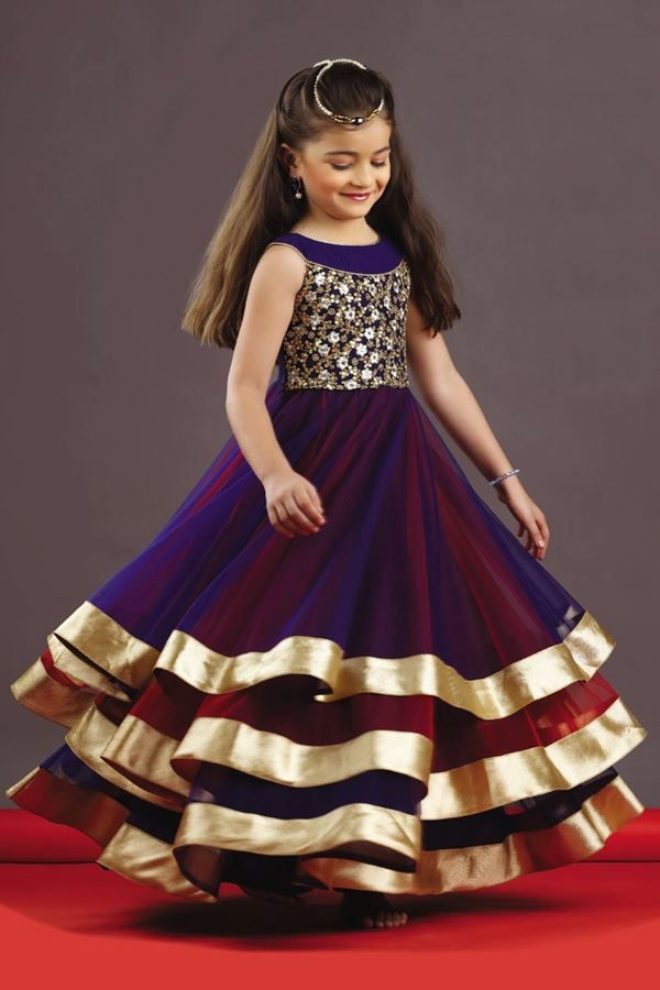 Make your daughter look showstopper as you wear this blue and red color gown. Featuring three layers, edge portion of gown is enhanced with golden shimmer border. Yoke portion is embroidered with zari and sequins work in floral pattern. Amazing colors together are used to craft this piece by making it worth flaunting.