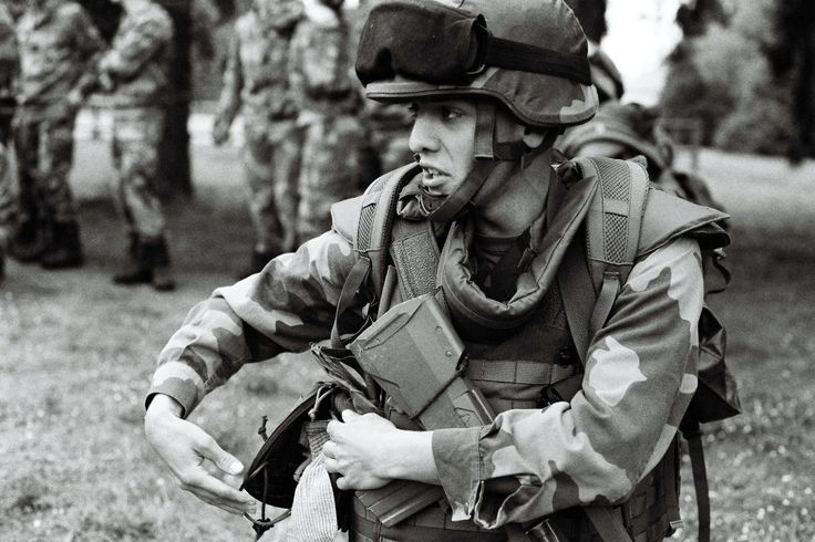 During a rescue training, a french officer is looking for a bandage while running toward a wounded soldier | Credit: Ryan Burton | Spec: Asahi Pentax K-1000, SMC Pentax-M 50mn 1:1,7, f=4 1/500 ISO: 400, HP5+ film