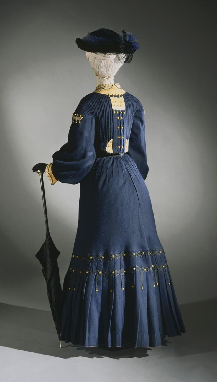 Woman's Winter Walking Outfit: Jacket and Dress  Artist/maker unknown, Belgian  Geography: Made in Brussels, Belgium, Europe Date: c. 1906 Medium: Fulled wool with silk appliqué, braid, embroidery, and silk-wrapped buttons Accession Number: 1955-29-15a,b