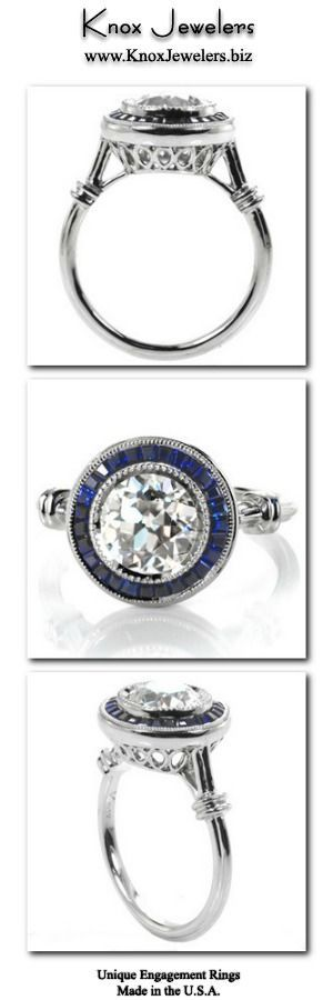 This beautiful engagement ring design is truly a show-stopper with its dazzling 2.00 carat round center diamond and deep blue sapphire tapering banquette framing halo. This vintage inspire custom ring features milgrain edging, wrapped shoulders and a pierced under basket. For more information about this made in the USA custom ring, click on pin.