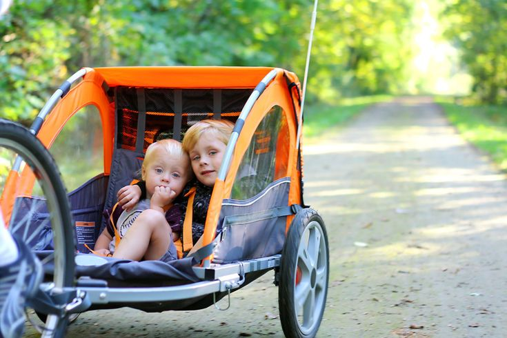 Everything you ever wanted to know about bike trailers for kids and babies, so you don't need to wait for them to grow up before getting back on your bike.