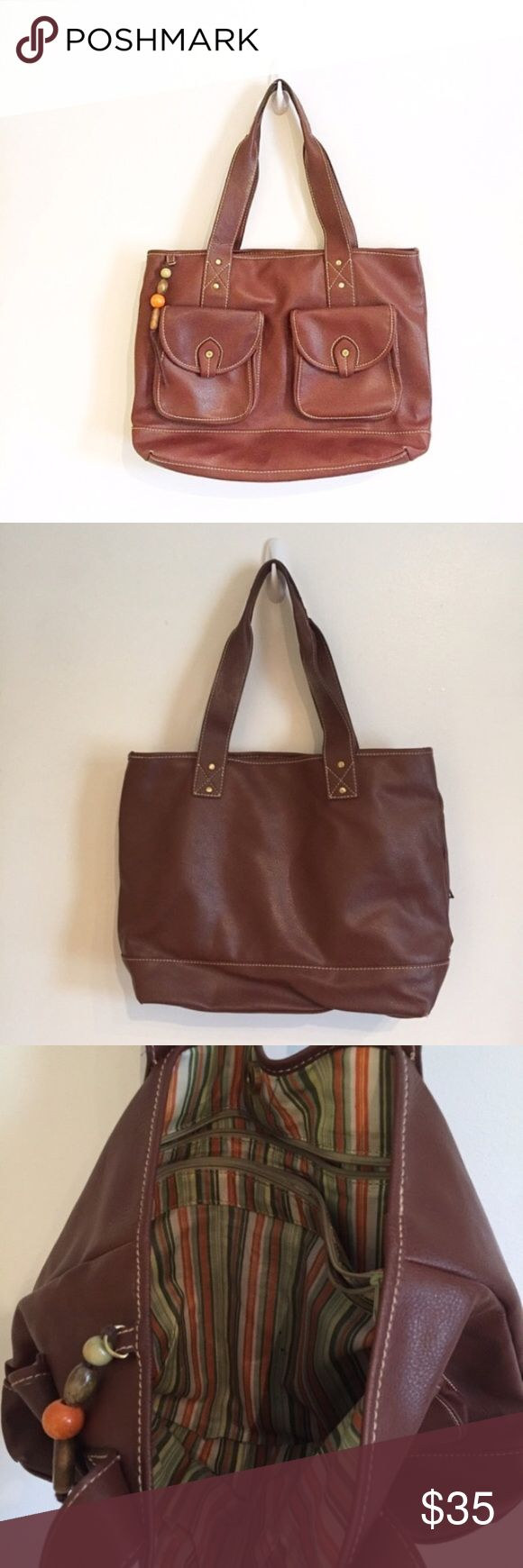 """RELIC by Fossil Brown Leather Tote Bag Purse Relic by Fossil. Big tote style purse with front pockets. Has a couple small pen marks and minor corner wear as shown in photos. Perfect everyday bag. Measures 16"""" Wide and 13"""" tall.  #relic #fossil #brown #earth #pocket #neutral #chic #tote #purse #basic #staple #leather #punkydoodle  No modeling Smoke free home I do discount bundles Relic Bags Totes"""