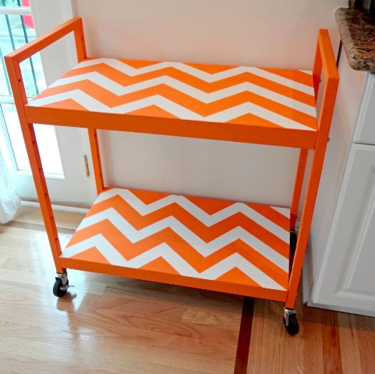 This is a crazy transformation!  These ugly TV carts can be found at nearly every thrift shop or garage sale.  Who would have thought they could be turned into something so cute?