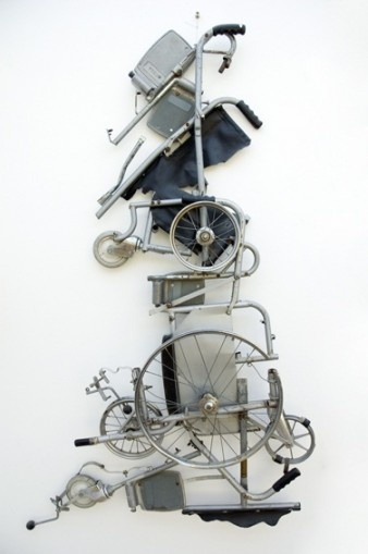 Great Britain from a wheelchair by Tony Heaton (UK). Image description: a 3D sculptural map in the shape of Great Britain made from disassembled wheelchair parts.