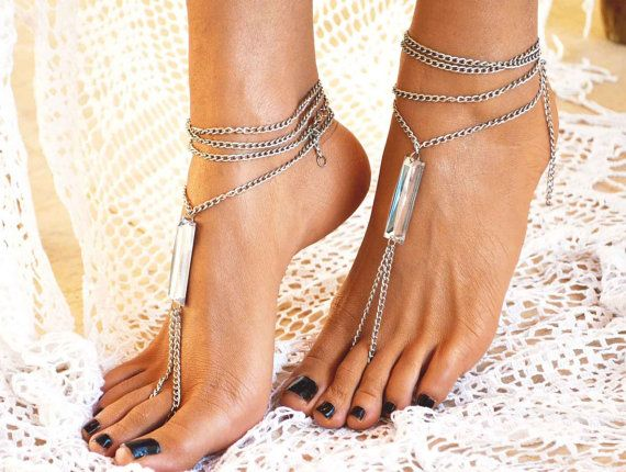 A pair of handcrafted barefoot sandals, with silver chain.   The barefoot sandals are decorated with a big ,shiny ,crystal charm! The closure is