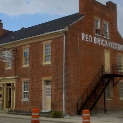 The Red Brick Tavern, in Lafayette, OH, is a classic roadside inn and tavern from the heyday of the National Road. Constructed between 1836 and 1837, it was in operation when the road was completed in front of the building. Brick used in the building was made from local clay, and wood used for the interior trim came from Zanesville.