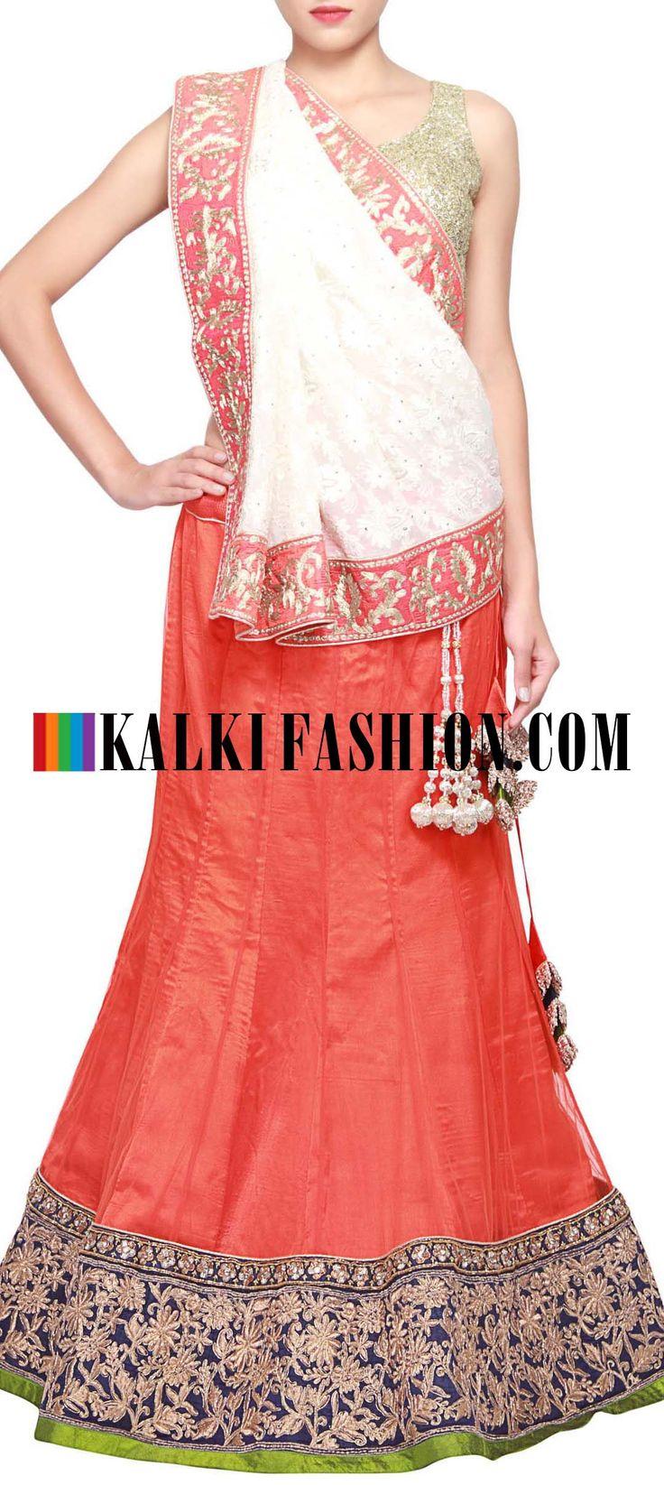 Get this beautiful lehenga here: http://www.kalkifashion.com/orange-net-lehenga-embellished-in-lucknowi-embroidery-only-on-kalki.html Free shipping worldwide.