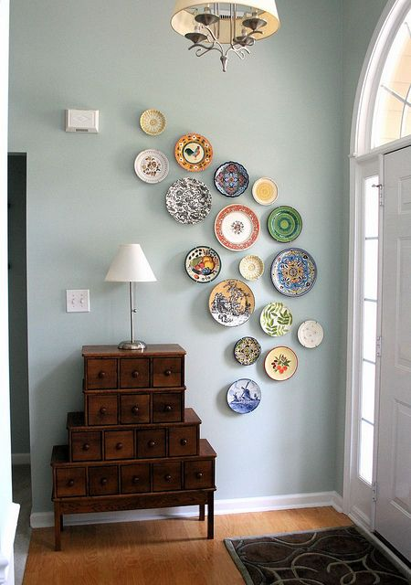 foyer plate wall by mmmcrafts, via Flickr... I'd love to collect interesting plates from my travels. Also, love the cabinet.