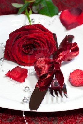 Romantic dinner setting with a rose Stock Photo