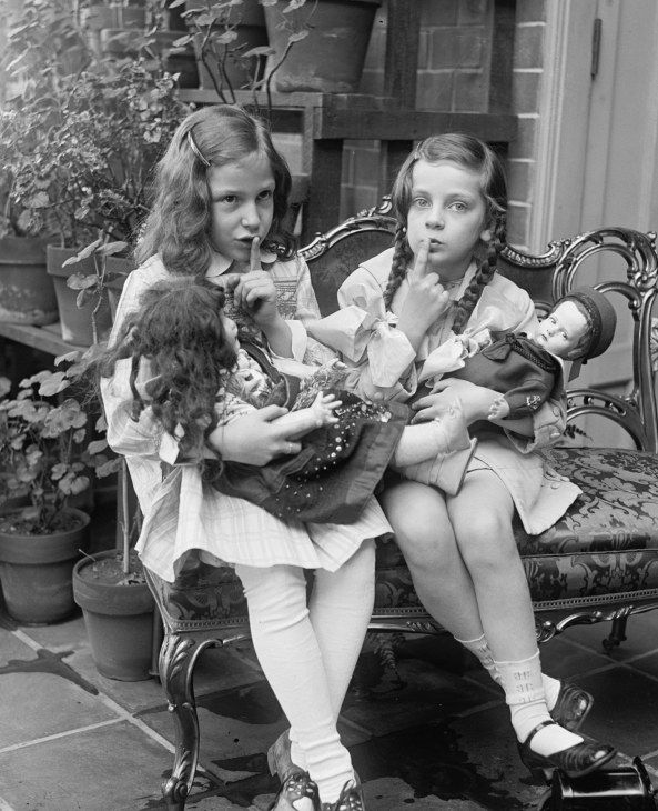 Early 1900s photo two young girls with dolls vintage black white photograph c9