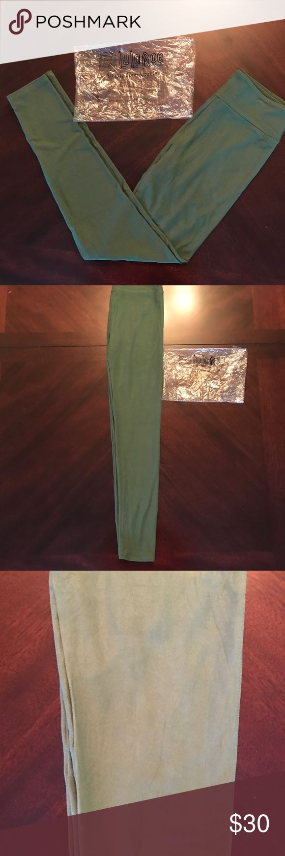 Lularoe solid green leggings OS Brand new, bought straight from consultant with original package. These solid green leggings I would classify as being an army/olive green. Based on the Lularoe color chart pictured I would say they are a mix of the three colors circled. Would go with tons of tops! Size OS fits 2-10. Shipped as pictured.  Fast shipper!  Please ask if you have any questions. LuLaRoe Pants Leggings