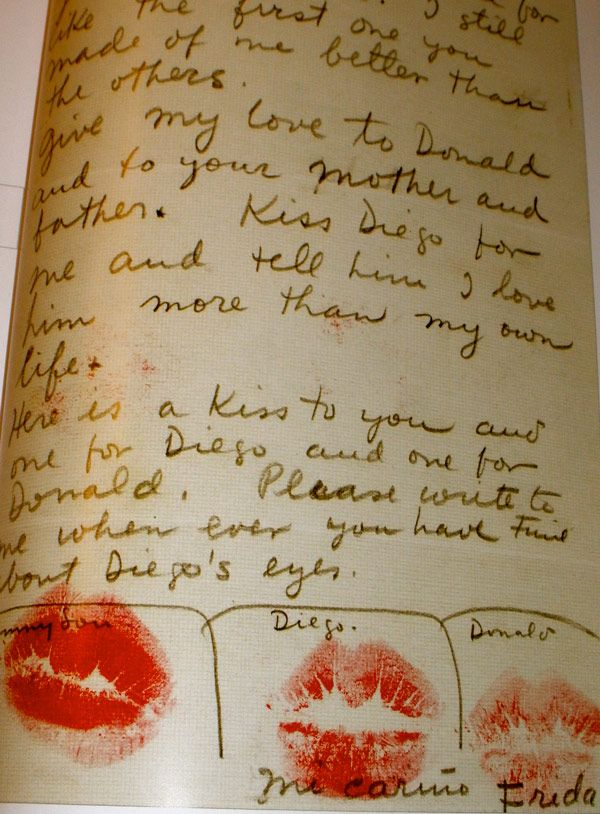 Letter from Frida Kahlo to a friend, with lipstick kisses for everyone.