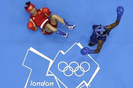 Aug 9 Ren Cancan of China is knocked down by Great Britain's Nicola Adams