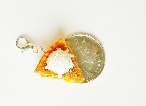 How about a delicious warm apple pie topped with a crispy crumble layer and a soft vanilla ice cream! The apples are nicely coated with cinnamon!  *Entirely handmade  * Your choice of gold or silver plated metal.  * If you would like these as earrings, do not hesitate to contact me.  * Sealed with glaze for protection. * Item comes packaged in a small decorated jewelry box.   *NOTE* In case you order more than one item, I will be placing them in the same box as long as they fit. Please…