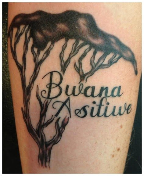 Bwana Asifiwi is Swahili for 'Praise the Lord' or more commonly translated as 'Praise God'. The tree is an Acacia Tree, the national tree of Kenya. ^^^Like the wording