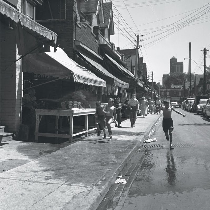 Kensington Market, Toronto, Ontario, Canada. This shot is from the 1950s looking East on the North side of Baldwin St.