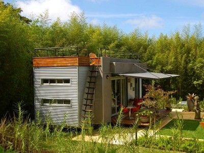 I could start out living here while I build my larger container home. Shipping container home with roof deck!