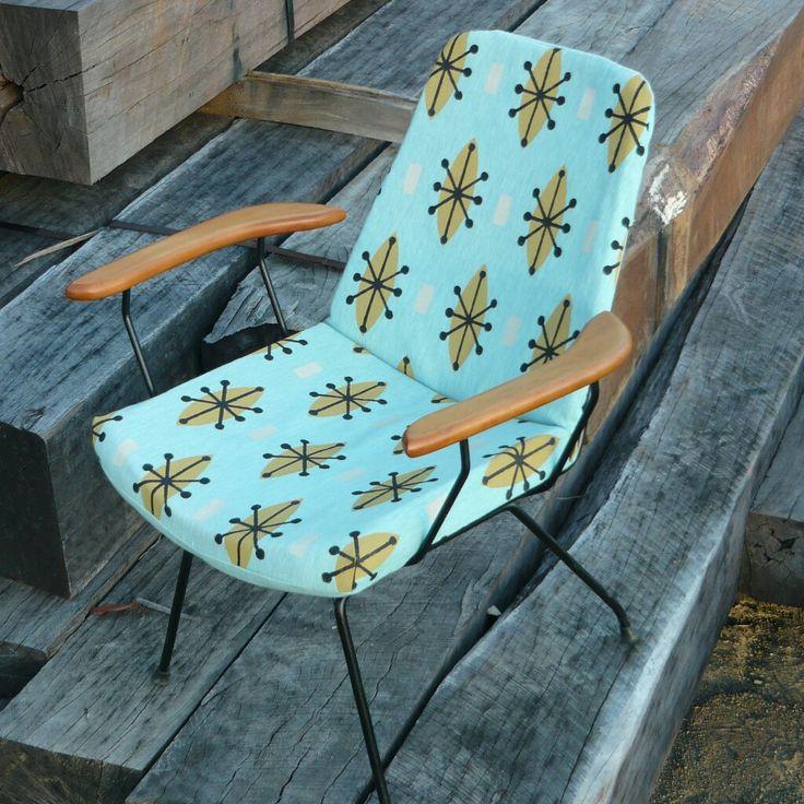 JUST SITTING AROUND A classic #1950s #Signet chair covered in #SocialFabric 's classic #Sputnik #design #handprinted by #Lynne Tanner #brisbaneTextile designer. #retrofabrics #midcenturymodern #upholsteryfabric #australiandesign #australianmade
