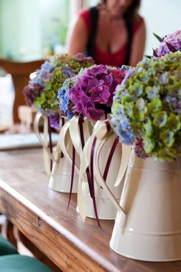 Old looking metal jugs make interesting alternatives to vases or urns for wedding flowers.  From Keith Riley photography Hannah & Wayne's Wedding