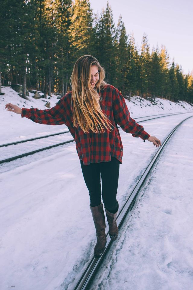 Red flannel, jeans, and boots. Casual fall or winter outfit.
