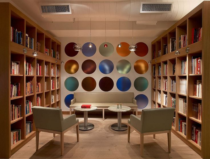 10 Questions With... Glen Coben | The library nook at Romera features an impressive collection of cookbooks from the Chef's personal Biblioteca Culinaria. Guests are invited to sip cocktails and browse the books. #design #interiordesign #interiordesignmagazine #architecture #library #furniture