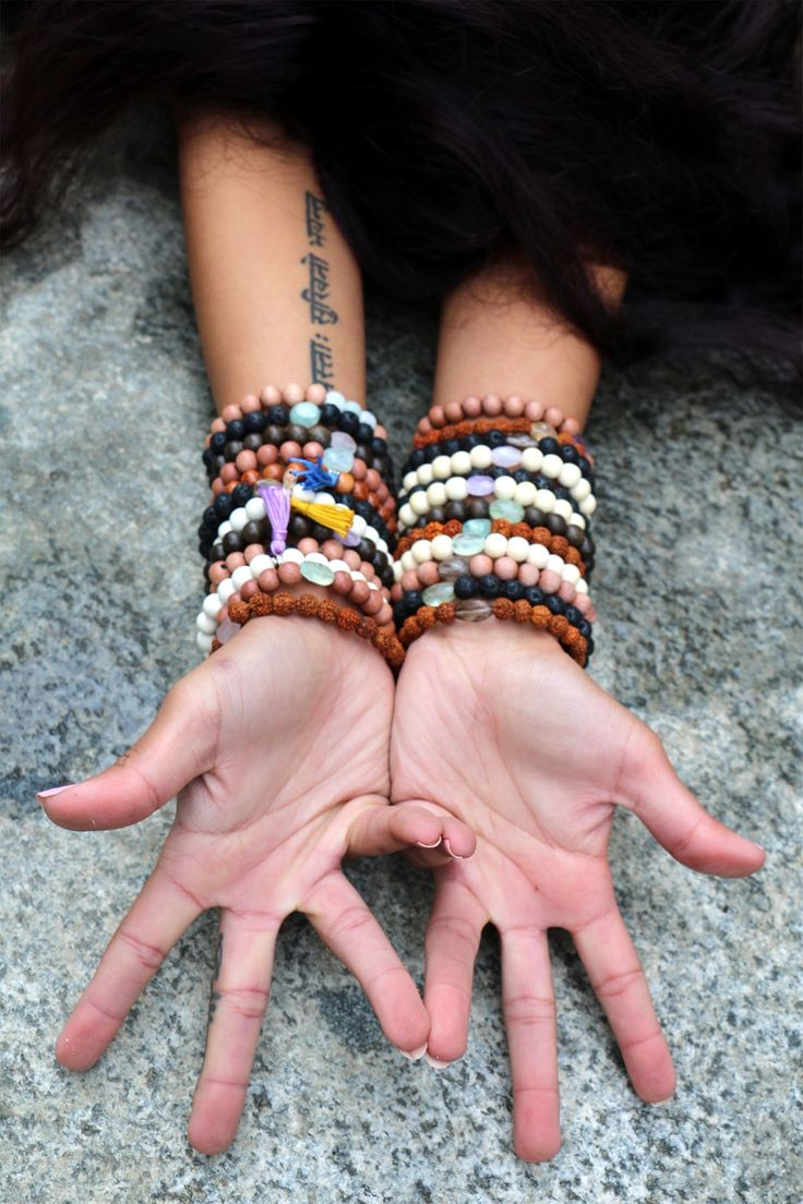 MALA BRACELETS Arm Party! These mala bracelets are stretchy and come in 4 bases; rosewood, graywood, lava, rudraksha and several different gemstones; Moonstone, Prenhite, Amethyst, Aquamarine, Rose Quartz.  See Stone Meaning Tab for more details. Stones are limited edition and vary in shapes and colouring.     See more on: http://www.karmaladesigns.bigcartel.com/