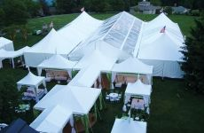 Chattanooga Tent Co. used a series of frame tents from Anchor Industries for this wedding, including a 40-by-100-foot clear gable-end Navi-t...