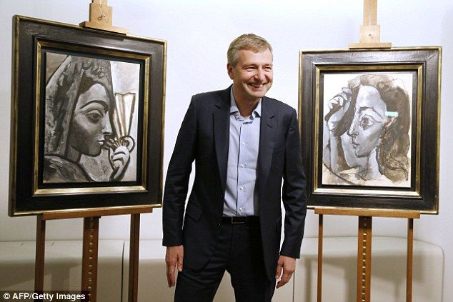 Return: Dmitry Rybolovlev poses in Paris in front of the two allegedly stolen Picasso paintings. 'Espagnole à l'éventail' (Woman with a Fan) is pictured left, while 'Tete de femme. Profil' (Head of a Woman. Profile) is right.    Mr Rybolovlev is giving up the works which are worth £18 million to highlight alleged criminality by Yves Bouvier. He says that he has endured a 'personal act of betrayal' and wants Mr Bouvier to face justice