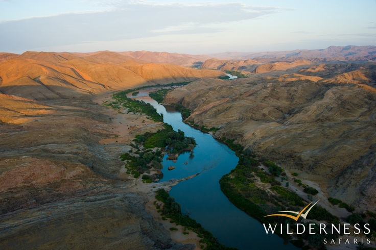Serra Cafema Camp - The Kunene River is the only permanent source of water in this region, the river creating a lush oasis along its banks - a winding band of green surrounded by the lunar like landscape of the Namib Desert which stretches to the Serra Cafema mountain range in the north.