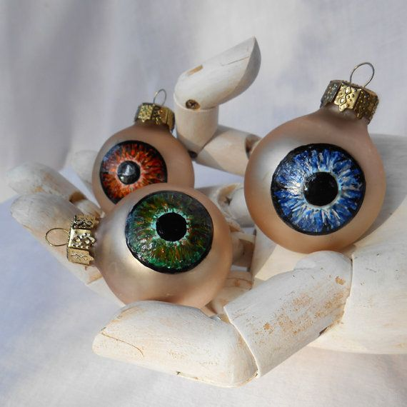 Upcycled glass ball ornament and acrylic paint; Sci-fi and horror theme for teens.