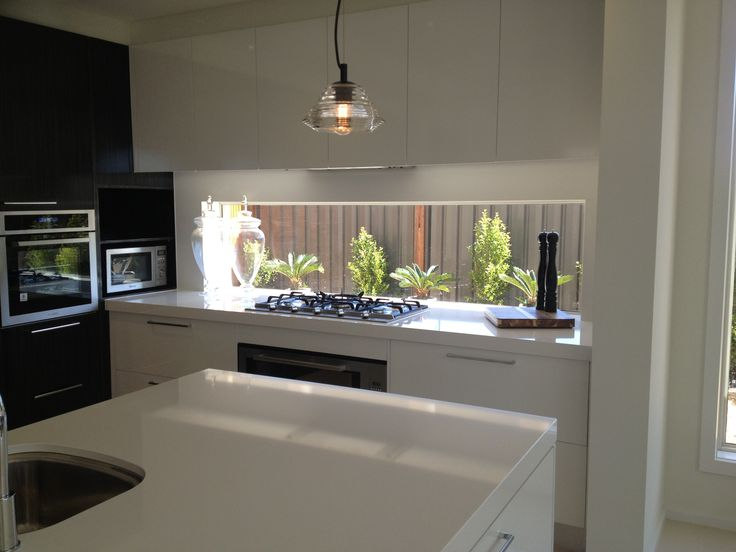 Window splashback - cupboards overhead ~ With optimal health often comes clarity of thought. Click now to visit my blog for your free fitness solutions!