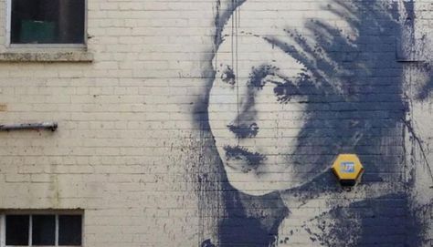 Banksy Graffiti: The Girl with the Pierced Eardrum