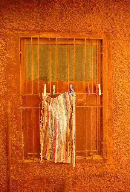 A ginger orange window scene in Thalia, Greece -- by Thalia Nouarou