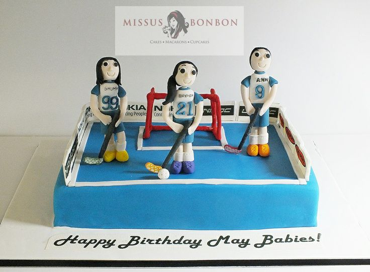 "The friends of these floorball team alumnus decided to get a birthday cake for them to relive their memories!   We made figurines of the three birthday girls and set them out for a ""game"", by equipping them with floorball sticks and jerseys."